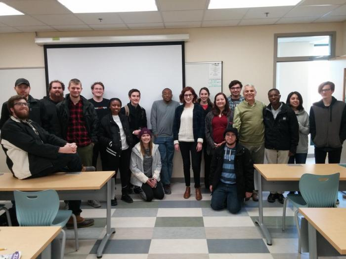 Lindsey Titus with a group of students and faculty